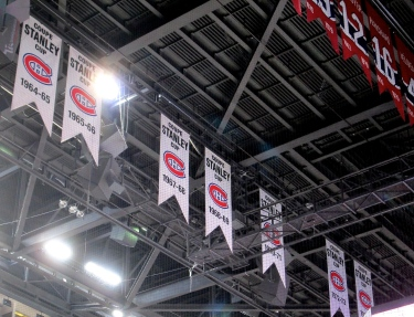 A few of the 24 Stanley Cup banners hanging from the rafters. None of them were won at the Bell Centre. You can also see some of the player banners for retired numbers. The Bell Centre also hosts the retired numbers from the Montreal Expos.