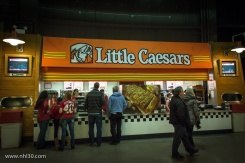 Convergence at its best! Little Caesars belongs to Mike Ilitch, owner of the Red Wings