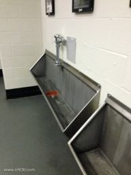 Trough style urinals.