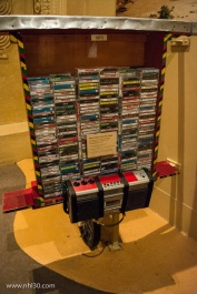 Travelling music salesman. This tape rack is attached to a bike.